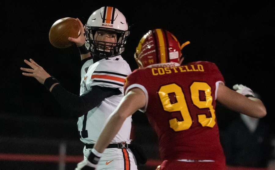 St.Charles East's Nathan Hayes (17) looks downfield against Batavia.