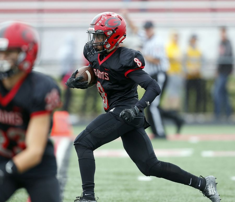 Glenbard East's Christopher Whitehead (8) finds some running room Saturday during football in Lombard.