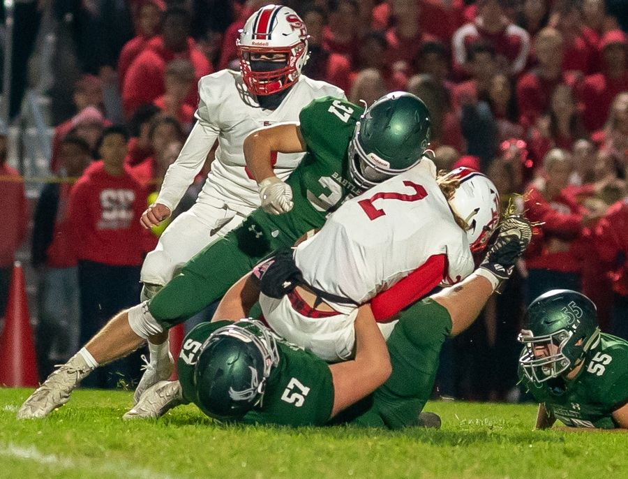 Bartlett's Max Nordlund (37) and Nathan Tomaso (57) tackle South Elgin's Ben Karpowicz.