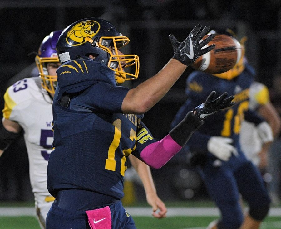 Round Lake's Dominick Tovar catches a first-down pass against Wauconda in a football game in the new Round Lake High School stadium in Round Lake Friday.
