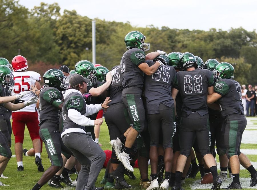 Glenbard West players celebrate after defeating Hinsdale Central in overtime in Glen Ellyn Oct. 19.