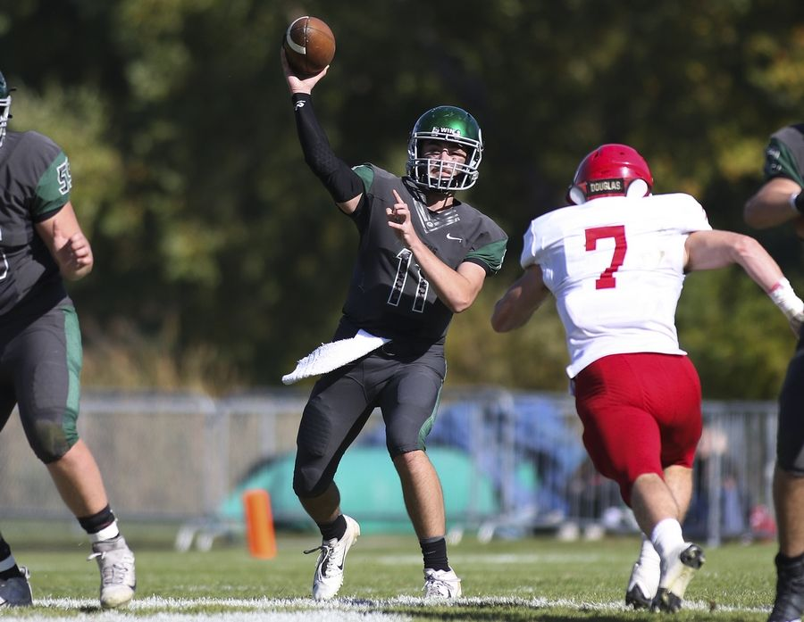 Glenbard West's Braden Spiech passes the ball against Hinsdale Central in Glen Ellyn Oct. 19.