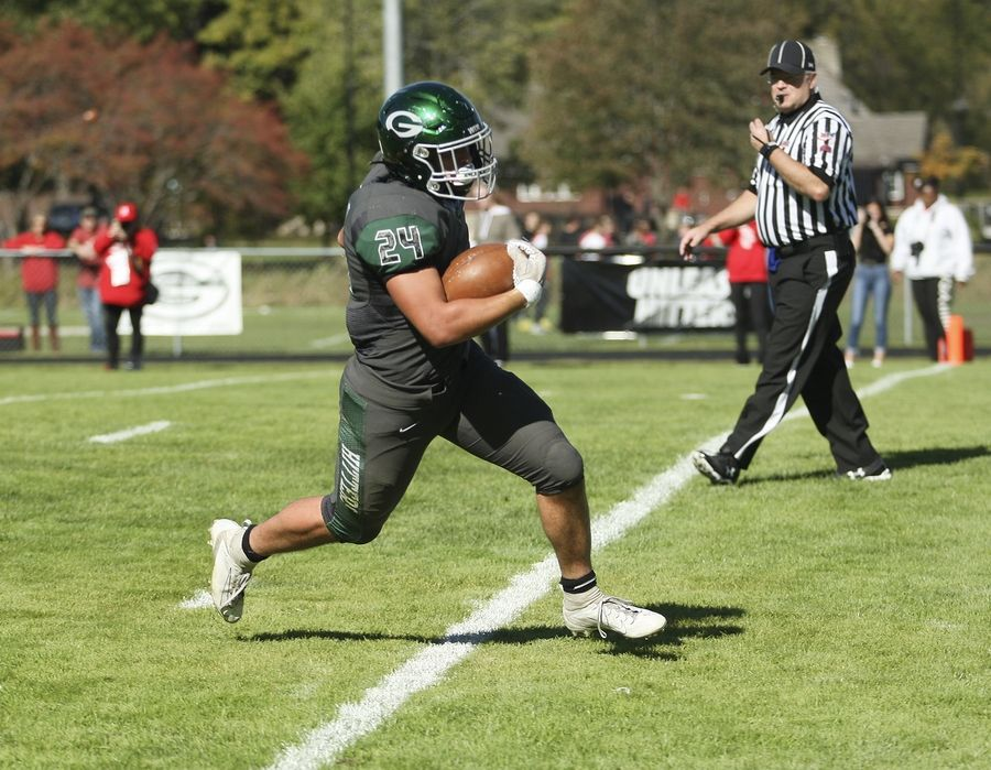Glenbard West's Nic Seifert runs in for a touchdown against Hinsdale Central in Glen Ellyn Oct. 19.