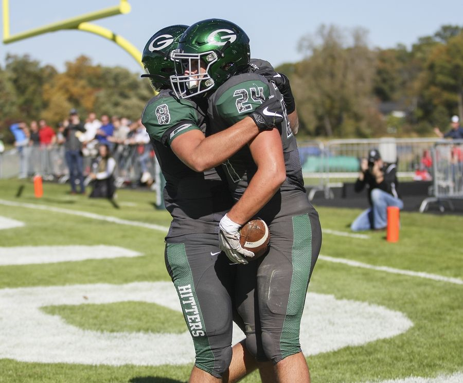 Glenbard West's Nic Seifert (24) celebrates with Denin Limouris (8) after a touchdown against Hinsdale Central in Glen Ellyn Oct. 19.