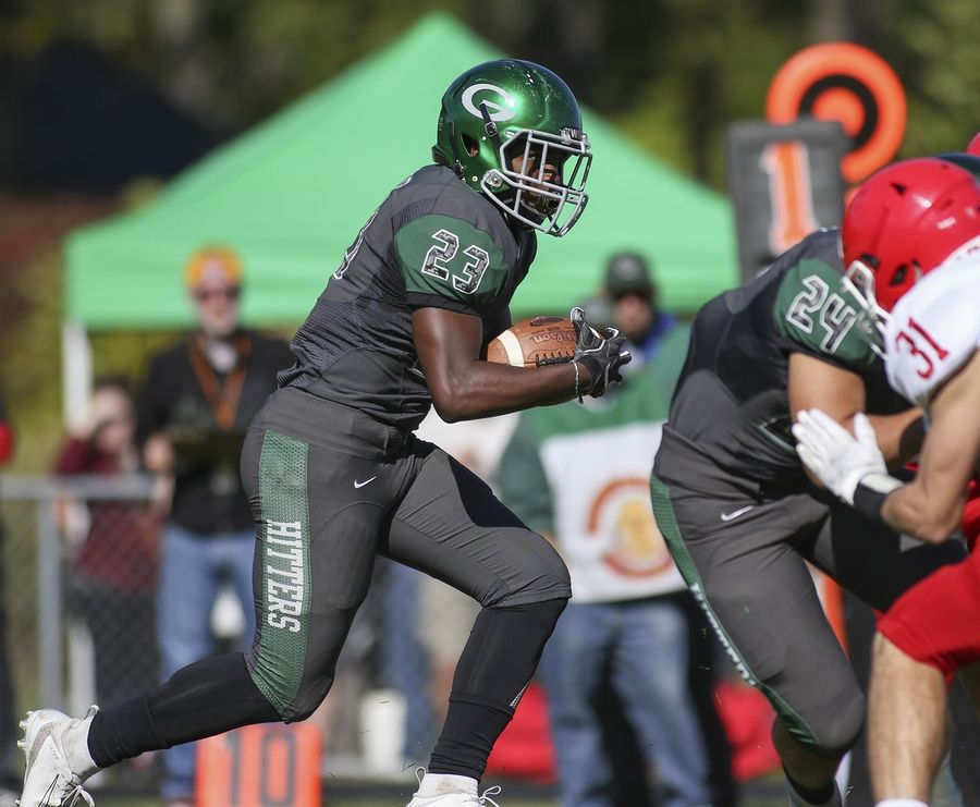 Glenbard West's Jaylen Moore carries the ball against Hinsdale Central in Glen Ellyn Oct. 19.