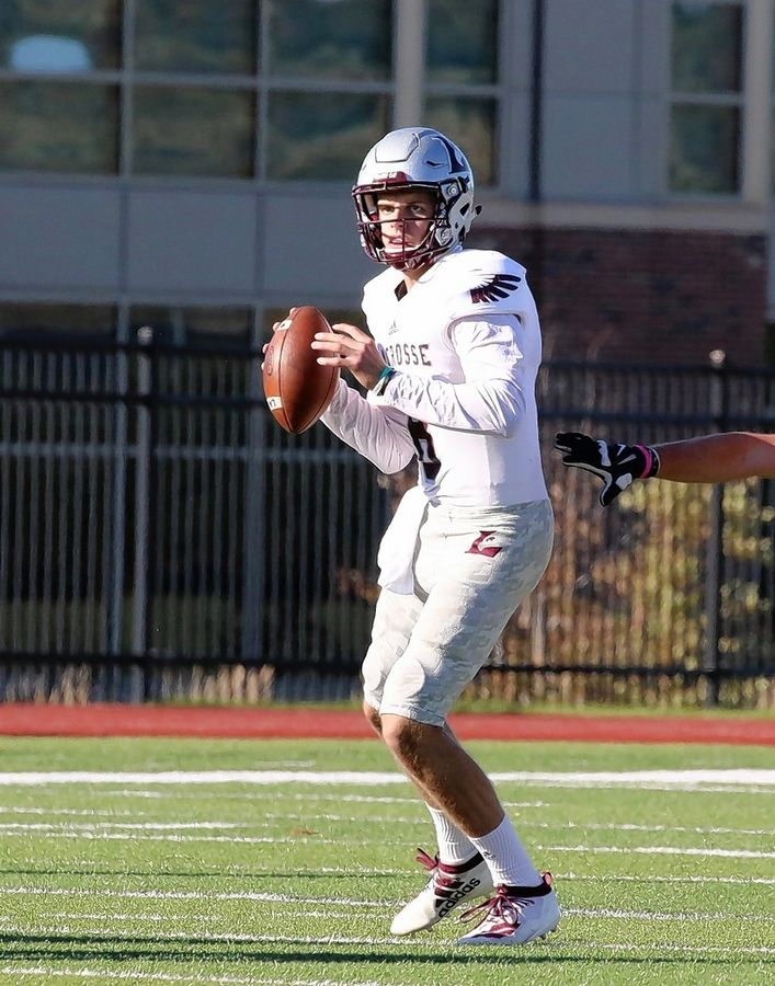 Lake Zurich graduate Evan Lewandowski put himself in the NCAA record book last Saturday by throwing 9 passing touchdowns in the University of Wisconsin-La Crosse's 63-49 win over UW-River Falls.