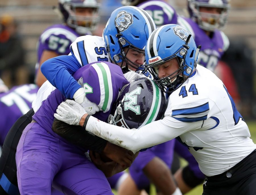 Lake Zurich's Hunter Welcing (44) and Jack Maskalunas sack Waukegan's Martiece Brown during action last season at Weiss Field in Waukegan.