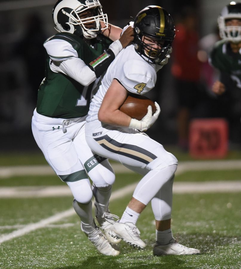 Grayslake North's Jason Hughes spins to try to escape Grayslake Central's Mari Coleman in a football game in Grayslake Friday.