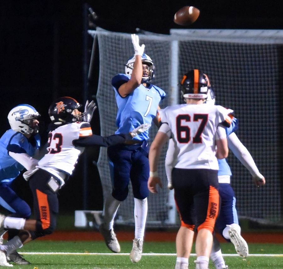 Prospect's Adam Mekky knocks down a last second two-point conversion pass by DeKalb that would have tied the game in a first round Class 7A playoff football game Friday in Mount Prospect.