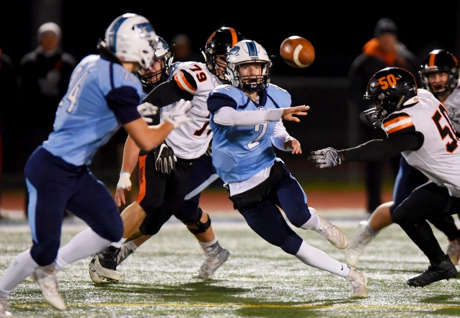 Prospect's Gary Moeller pitches the ball to Luke Zardzin against DeKalb in the second quarter in a first round Class 7A playoff football game Friday in Mount Prospect.