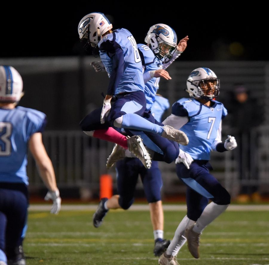 Prospect's Matthew Meyer and Owen Walter celebrates Walter's block of a DeKalb point after kick in a first round Class 7A playoff football game Friday in Mount Prospect.