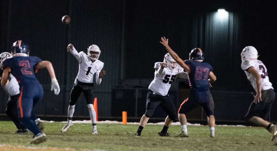 Elgin's Jeffery Lomax (1) throws a pass to Alexander West (34) against Oswego during a 8A playoff game at Oswego High School in Oswego, IL on Friday, November 01, 2019