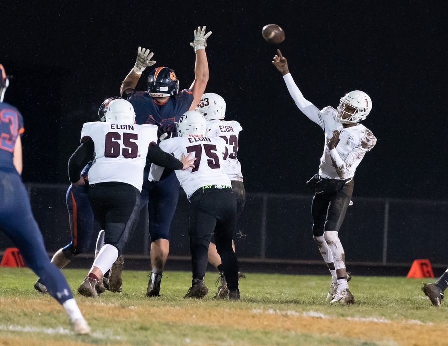 Elgin's Jeffery Lomax (1) throws a pass against Oswego during a 8A playoff game at Oswego High School in Oswego, IL on Friday, November 01, 2019