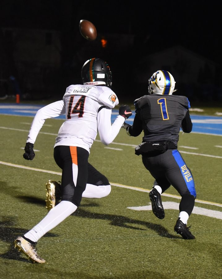 Warren's Christian Phillips is wide open for a reception in front of Plainfield East's Bryce Jackson, setting up a first-and goal during the second quarter of the Class 8A football playoffs in Gurnee Saturday.