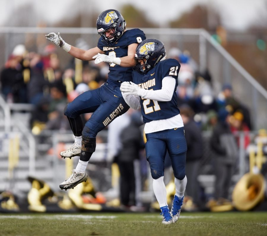 Neuqua Valley's Nathan Williamson and Christian Allen celebrate a play against Conant in a first-round playoff football game in Naperville Saturday.