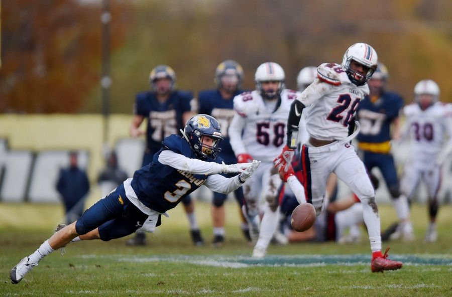 Neuqua Valley's Garrett Stare can't reach a long pass as Conant's Kobe Gilbert defends in a first-round playoff football game in Naperville Saturday.