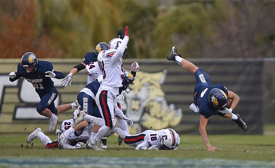 Neuqua Valley's Mark Gronowski is upended by Conant's Krytian Tonchev in a first-round playoff football game in Naperville Saturday.