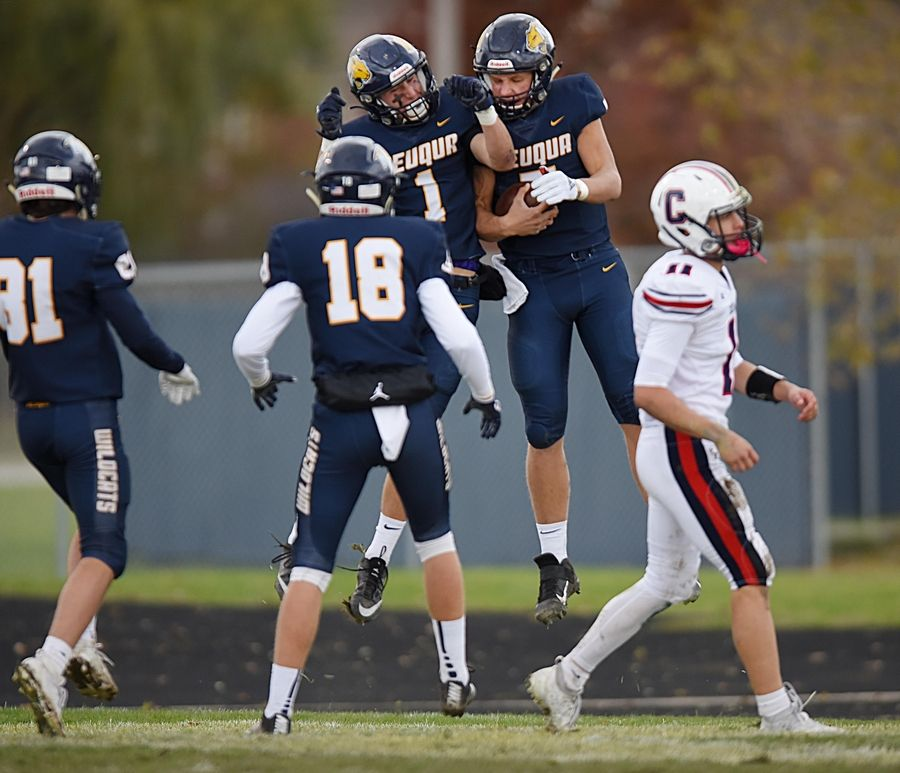 Neuqua Valley's Mark Gronowski, right, and teammate Patrick Hoffmann celebrate Gronowski's touchdown run in the first quarter against Conant in a first-round playoff football game in Naperville Saturday.