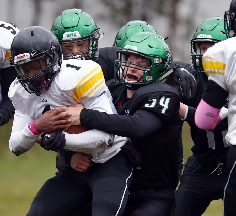 Luke Breier (54), St. Edward's leading tackler, wraps up Chicago Orr's Diamante Paxton (1) during last week's Green Wave win. This week they travel to Fieldcrest to face the state's No. 2 ranked team.