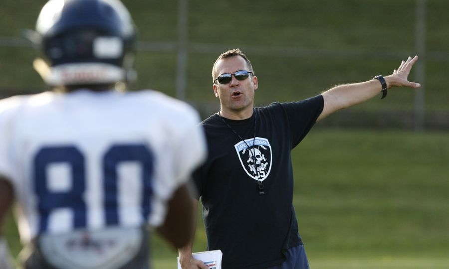 Lake Park head football coach Chris Roll runs the offense during practice.