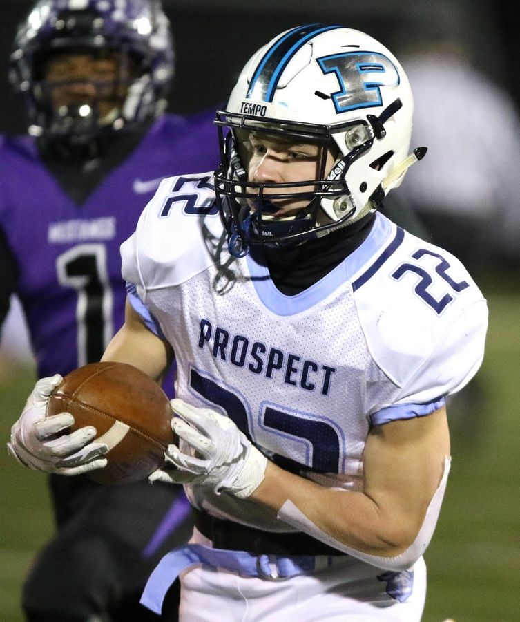 Prospect's Noah Marx dashes toward the end zone with a touchdown during playoff football at Robert A. Hoese Field on the campus of Rolling Meadows High School Friday night.