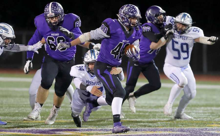 Rolling Meadows' Chris Divito runs the ball.