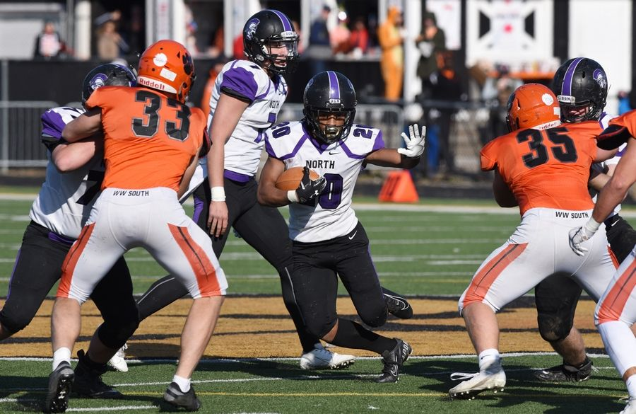 Downers Grove North's Joshua Lumpkin carries the ball during Saturday's game against Wheaton Warrenville South.