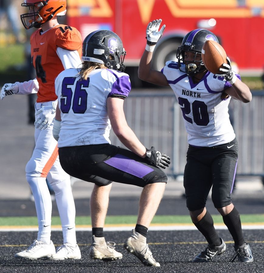 Downers Grove North's Joshua Lumpkin, right, celebrates his touchdown with teammate Seth Peterson during Saturday's game against Wheaton Warrenville South.