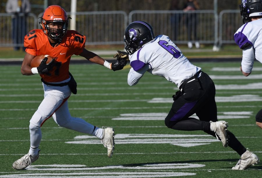 Wheaton Warrenville South's Kaleb Clousing looks to get past Downers Grove North's Henry Gates during Saturday's game in Wheaton.