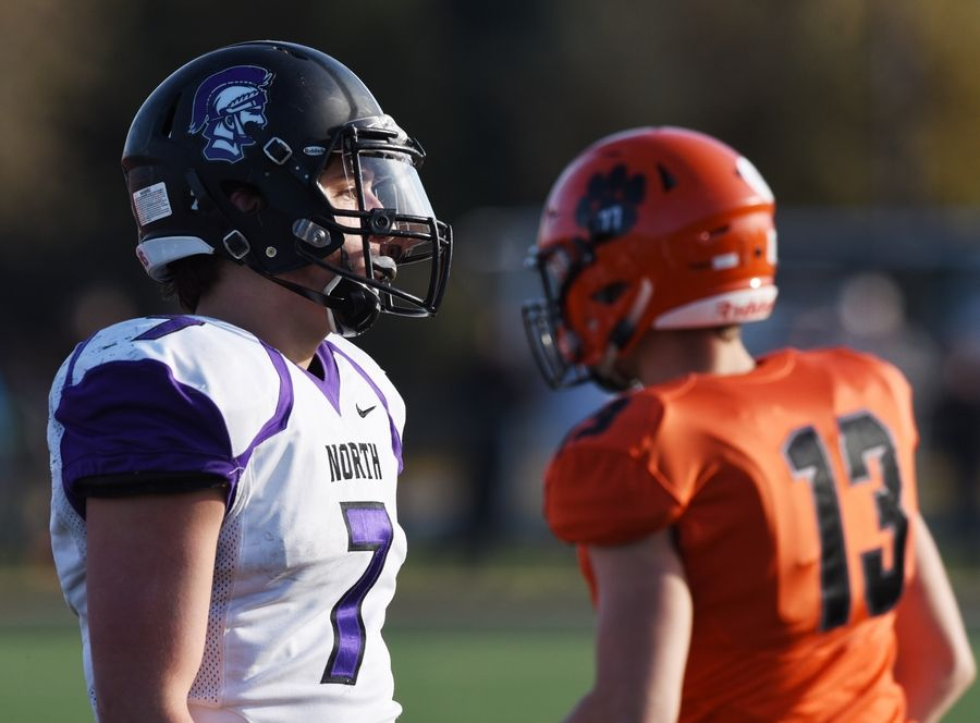 Downers Grove North quarterback Drew Cassens walks to his team's sideline after a failed fourth-down conversion attempts during Saturday's game against Wheaton Warrenville South.