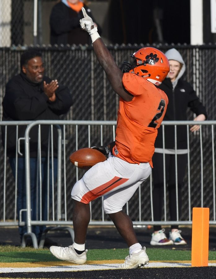 Wheaton Warrenville South's Prince Lankah celebrates his touchdown during the fourth quarter against Downers Grove North during Saturday's game in Wheaton.