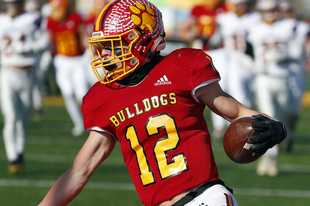 Batavia's Sam Barus celebrates a touchdown Saturday during the Bulldogs' win over Hononegah in the second round of the Class 7A playoffs. The Bulldogs play at Nazareth on Saturday while Cary-Grove travels to Prairie Ridge.