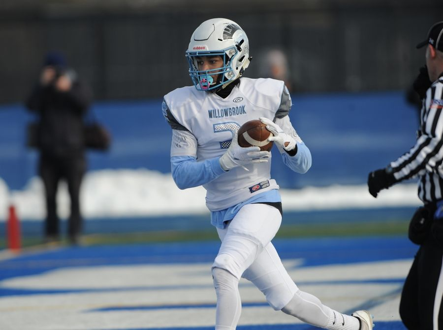 Willowbrook's Everett Stubblefield moves into the end zone for the score in the Class 7A football playoffs at Lake Zurich on Saturday.