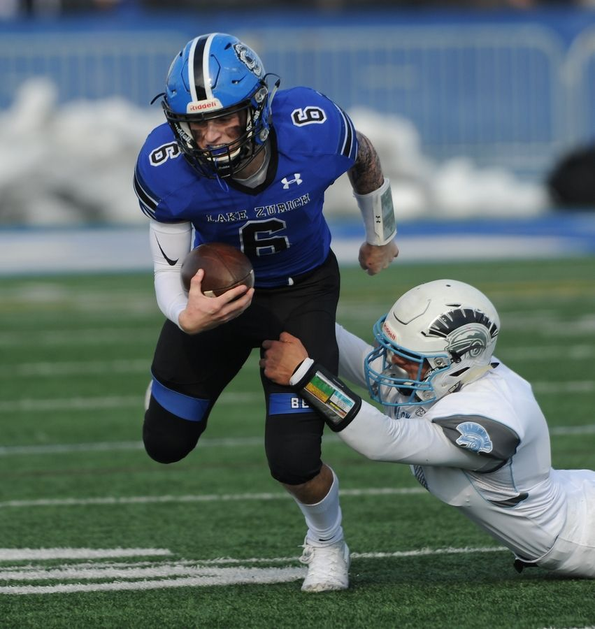 Willowbrook's Mohammad Ayesh brings down Lake Zurich quarterback Jack Moses in the Class 7A football playoffs at Lake Zurich on Saturday.