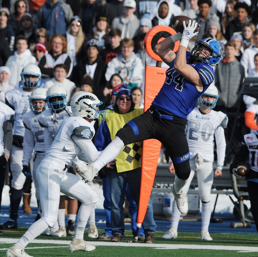 Lake Zurich's Hunter Welcing makes a grab for 14 yards as Willowbrook's Mohammad Ayesh applies pressure in the first quarter of the Class 7A football playoffs at Lake Zurich on Saturday.