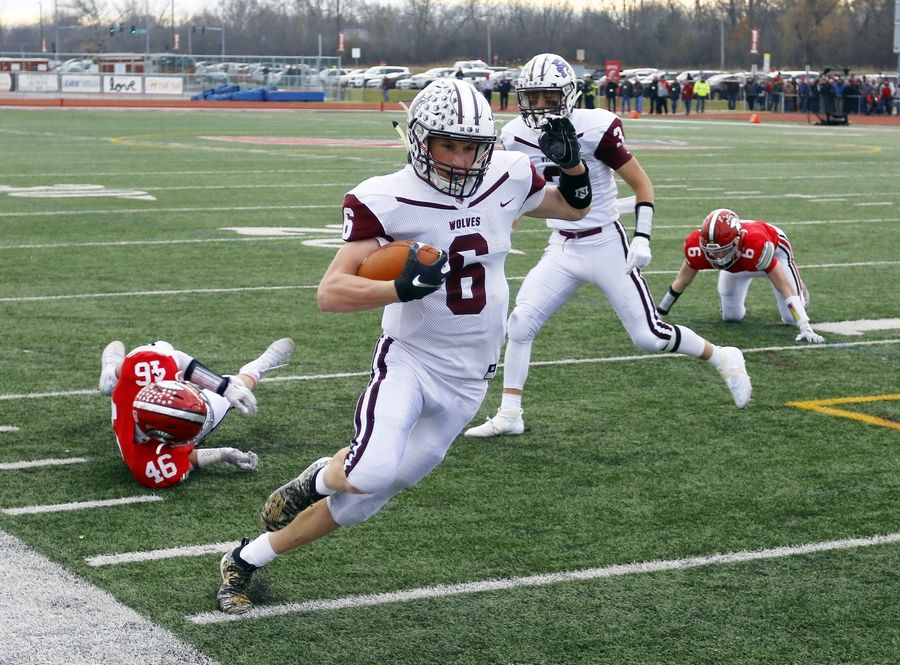 Prairie Ridge's Taidhgin Trost picks up yardage during the Wolves' 49-16 Class 6A semifinal win at Deerfield Saturday.