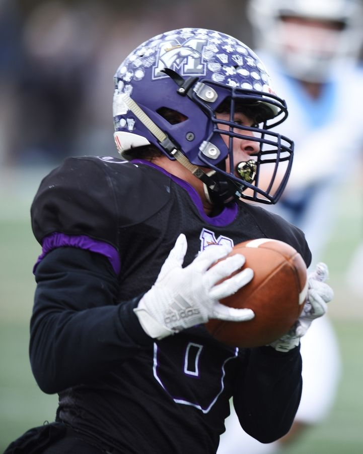 Rolling Meadows' Jordan Wiles catches a pass and turns upfield during the Class 7A state football semifinal against Nazareth Saturday.