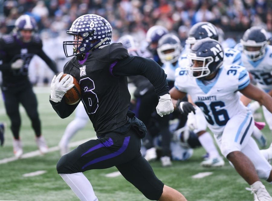 Rolling Meadows' Jordan Wiles carries the ball the Class 7A state football semifinal against Nazareth Saturday.