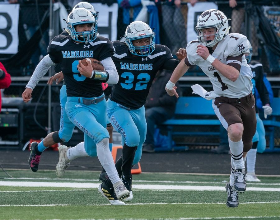 Willowbrook's Mohammad Ayesh (9) runs after intercepting a pass by Mt.Carmel's Justin Lynch (1) during a 7A semifinal football game at Willowbrook High School in Villa Park, IL on Saturday, November 23, 2019