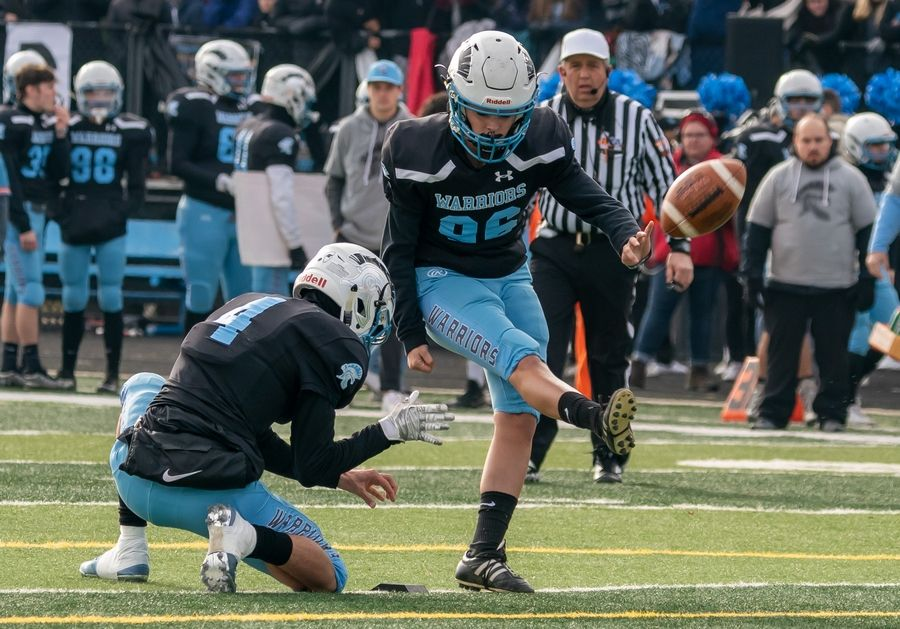 Willowbrook's Izabelle Manning (96) attempts to kick a point after against Mt.Carmel during a 7A semifinal football game at Willowbrook High School in Villa Park, IL on Saturday, November 23, 2019