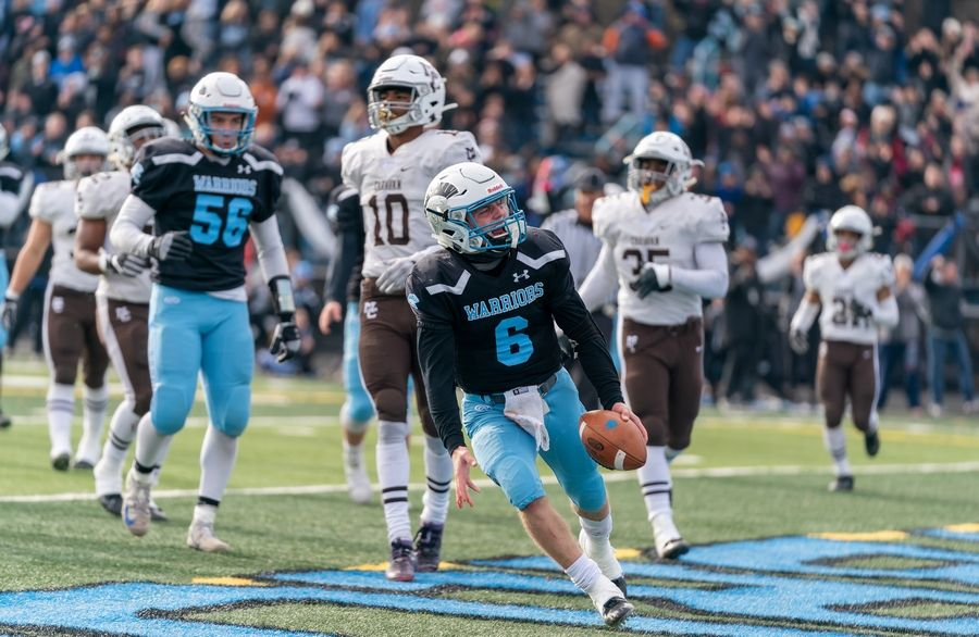 Willowbrook's Sam Tumilty (6) reacts after scoring a touchdown against Mt.Carmel during a 7A semifinal football game at Willowbrook High School in Villa Park, IL on Saturday, November 23, 2019