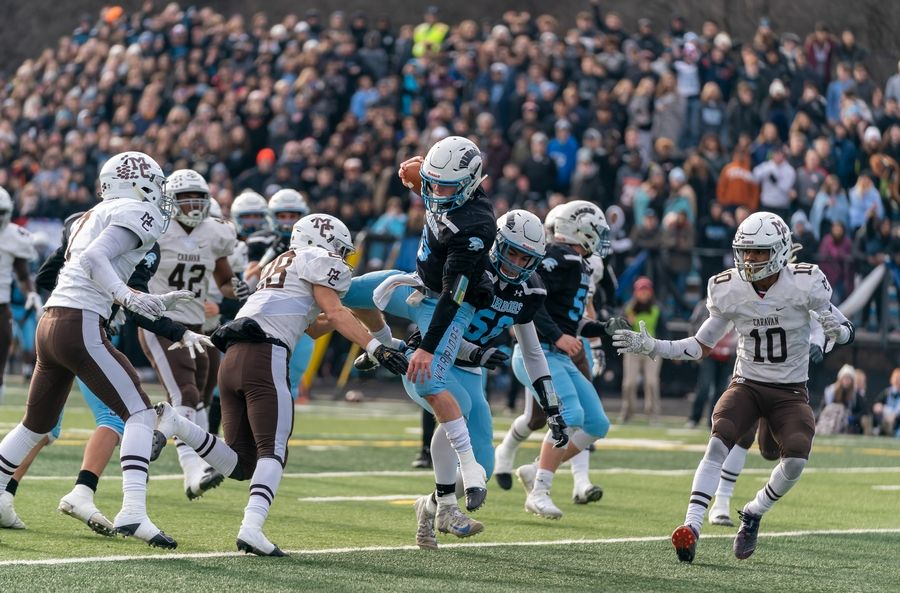 Willowbrook's Sam Tumilty (6) carries the ball on a keeper and leaps into the end zone for a touchdown against Mt.Carmel during a 7A semifinal football game at Willowbrook High School in Villa Park, IL on Saturday, November 23, 2019