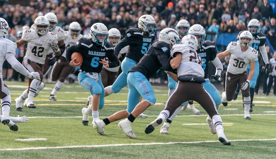 Willowbrook's Sam Tumilty (6) carries the ball on a keeper against Mt.Carmel during a 7A semifinal football game at Willowbrook High School in Villa Park, IL on Saturday, November 23, 2019