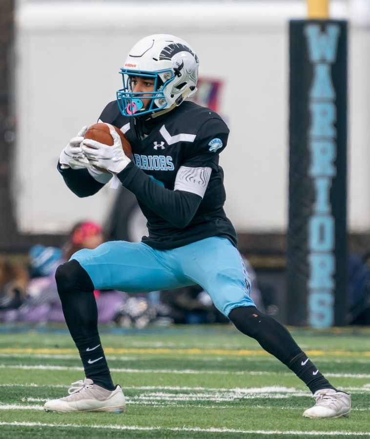 Willowbrook's Everett Stubblefield (3) runs after the catch against Mt.Carmel during a 7A semifinal football game at Willowbrook High School in Villa Park, IL on Saturday, November 23, 2019