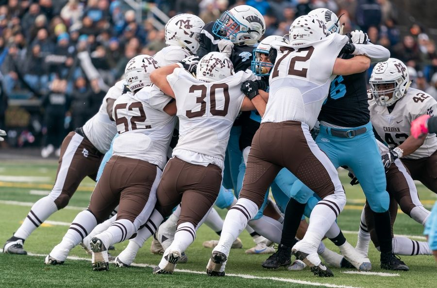 Mt.Carmel's defensive line battles Willowbrook's offensive line during a goal line play in a 7A semifinal football game at Willowbrook High School in Villa Park, IL on Saturday, November 23, 2019