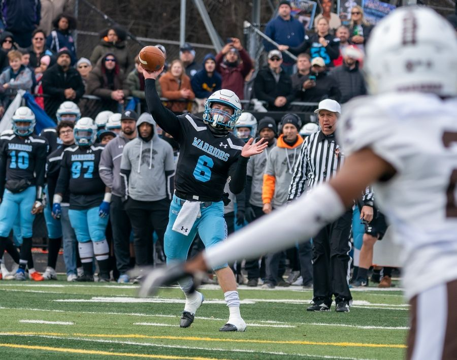 Willowbrook's Sam Tumilty (6) throws a pass against Mt.Carmel during a 7A semifinal football game at Willowbrook High School in Villa Park, IL on Saturday, November 23, 2019