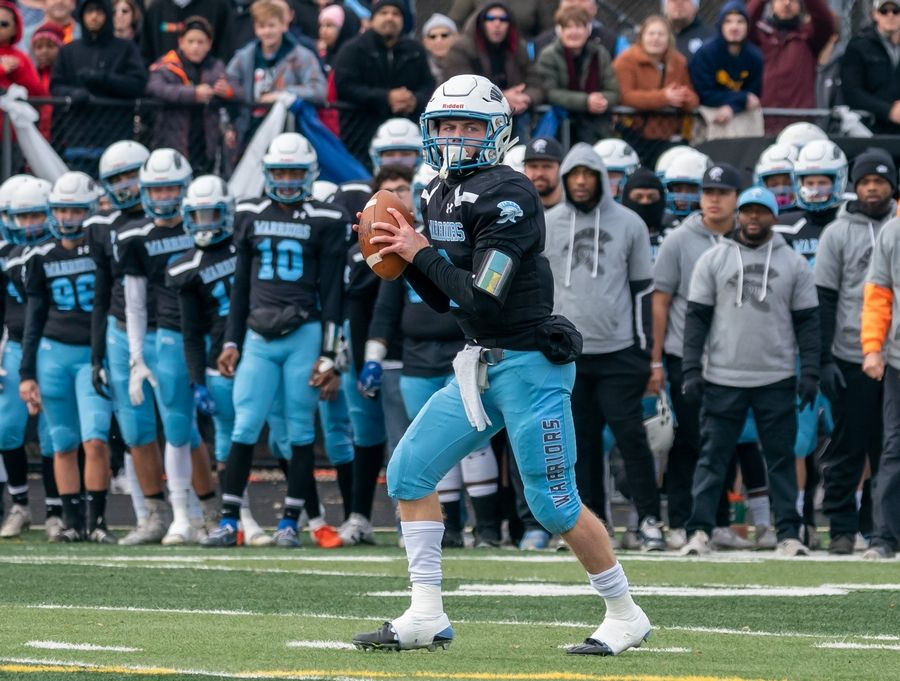 Willowbrook's Sam Tumilty (6) stands in the pocket against Mt.Carmel during a 7A semifinal football game at Willowbrook High School in Villa Park, IL on Saturday, November 23, 2019