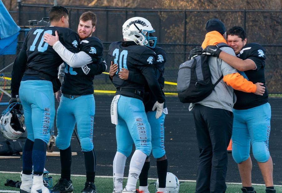 Willowbrook players console one another after a season ending loss to Mt.Carmel in a 7A semifinal football game at Willowbrook High School in Villa Park, IL on Saturday, November 23, 2019