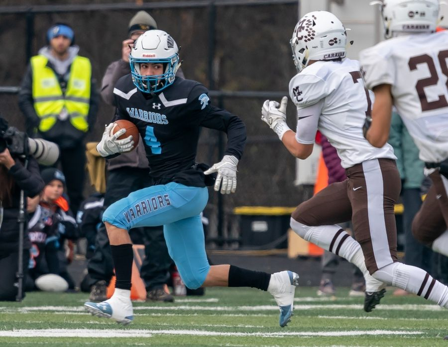 Willowbrook's Alessio Battaglia (4) runs after the catch against Mt. Carmel during a Class 7A semifinal football game at Willowbrook High School in Villa Park on Saturday.