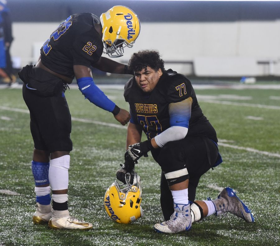 Warren's Torris Childs, left, comforts teammate Jaiden Lowery following the Blue Devils' 12-0 loss to Lincoln-Way East during the IHSA Class 8A state football championship game at Northern Illinois University in DeKalb Saturday.